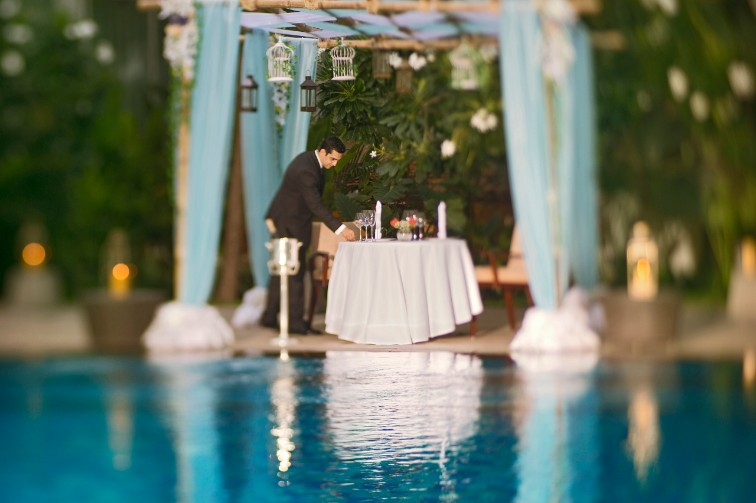 Candle light dinner by the pool at Taj Coromandel