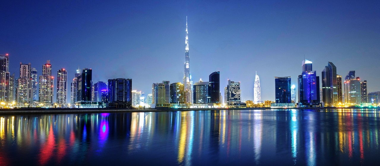 F4RKNF Night view of Burj Khalifa and Creek at new Business Bay district of  Dubai United Arab Emirates