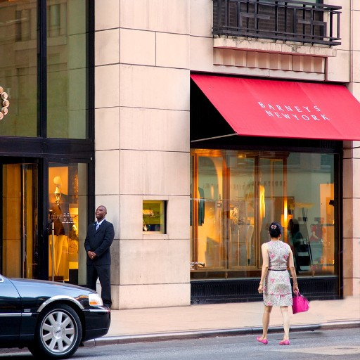 Shoppers along 5th Avenue at Barneys, Manhattan, New York City USA